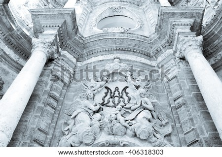 Architectural detail of the Baroque facade of the Metropolitan Cathedral (Saint Mary's Cathedral) in Valencia, Spain - stock photo