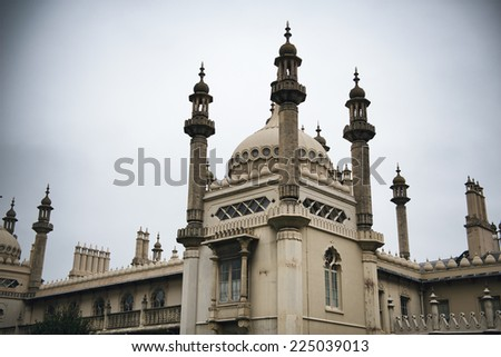 Architectural detail of the Brighton Royal Pavilion showing the Indian influence in the ornate rooftop and domes of this royal pleasure palace and popular landmark - stock photo