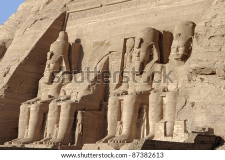 architectural detail of the historic Abu Simbel temples in Egypt (Africa) showing some ancient stone sculptures - stock photo