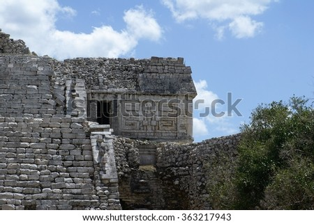 Architectural detail on a Mayan building in Chichen Itza - stock photo