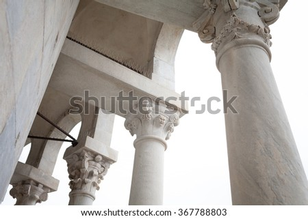Architectural detail with columns and arches of the small loggia located in the top of the leaning tower of Pisa, Italy. - stock photo
