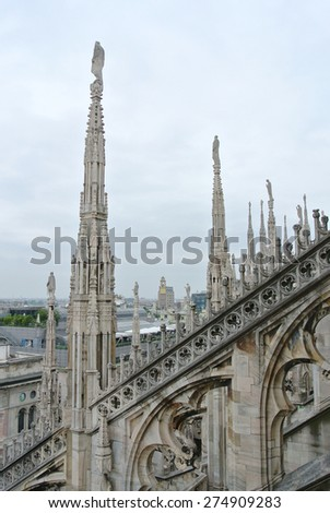 Architectural details from the roof of Milan Cathedral (Duomo di Milano) built in Gothic style - stock photo