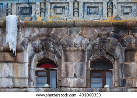 Architectural details of old corn exchange in Rybinsk. Two windows and ice - stock photo