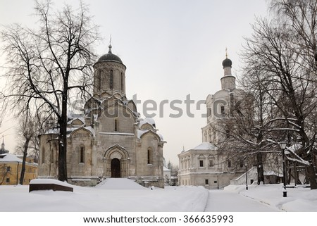 Architectural Ensemble of St. Andronik Monastery Covered with Snow. The ancient four-pillared Savior Cathedral (1420-1427) at the left and the Church of Archangel Michael (1690s) at the right - stock photo