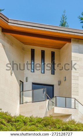 Architectural frafment: side of the modern house with the balcony. Vertical. - stock photo