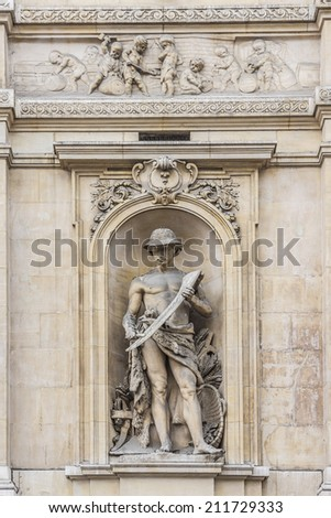 Architectural fragment of Famous building of Stock Exchange (Bourse de Bruxelles, Beurs van Brussel). Building was erected from 1868 to 1873 in the Neo-Renaissance style. Brussels, Belgium. - stock photo