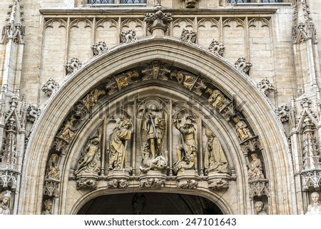 Architectural fragment of Town Hall (Hotel de Ville) on Grand Place (Grote Markt) - central square of Brussels - most important tourist destination and most memorable landmark in Brussels, Belgium. - stock photo