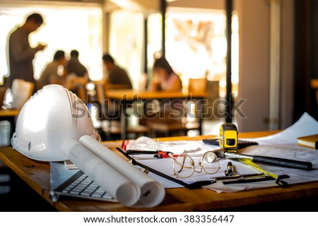 Architectural Office desk background construction project ideas concept, With drawing equipment with mining light - stock photo