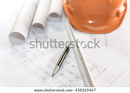 architectural plans project drawing and pen  with blueprints rolls, ruler and orange helmet, architect engineering and contractor concept - stock photo