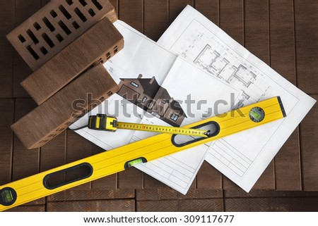 Architectural project and construction's tools on brown clinker brick background - stock photo