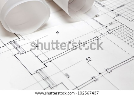 architectural project. architect rolls and plans - stock photo