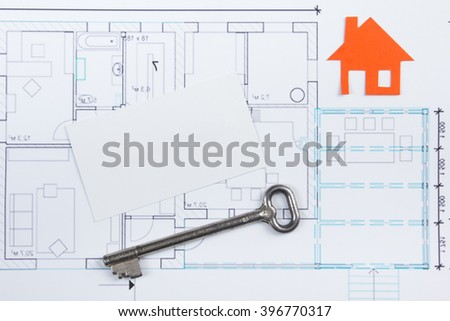 Architectural project, blueprints, key with house figure and blank business card on wooden background. Real Estate Concept. Top view. - stock photo