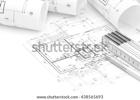 architectural project with rolled blueprints and technical drawings - stock photo