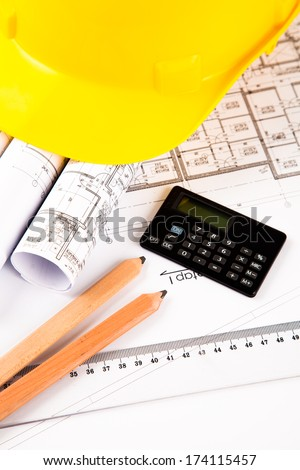 architectural project. yellow hardhat - stock photo