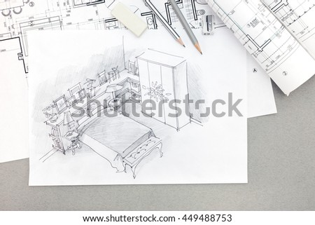 architectural sketch of bedroom with pencils, eraser, sharpener and blueprints - stock photo