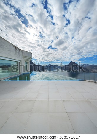 Architecture, beautiful landscape from a modern house with infinity pool - stock photo