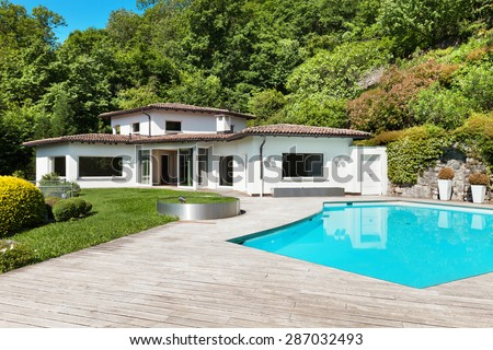 Architecture, beautiful villa with swimming pool, outdoors - stock photo
