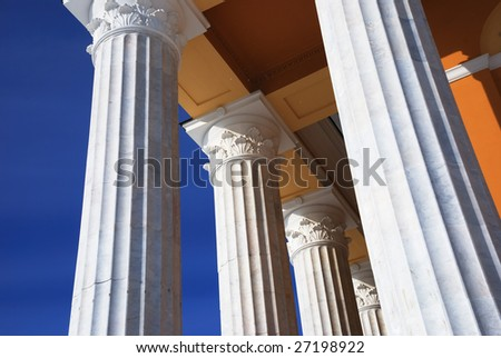 architecture, classical columns against blue sky, horizontal - stock photo