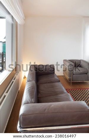 Architecture, comfortable apartment, living room with leather divan - stock photo
