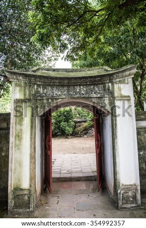 Architecture inside the Temple of Literature in Hanoi, Vietnam. This building is of utmost cultural importance and is beautifully architectured with ancient architectures. - stock photo