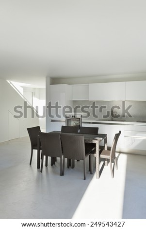 Architecture, interior of a modern house, dining table - stock photo