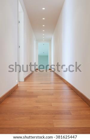 Architecture, long corridor of a modern building, parquet floor - stock photo