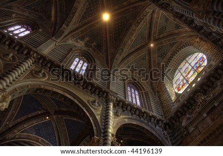 Architecture, marble and stained glass inside the Duomo in Siena Cathedral, Siena, Tuscany, Italy. - stock photo