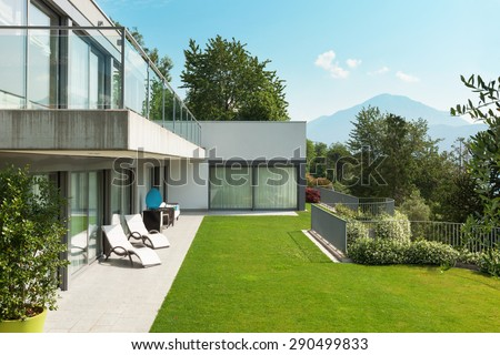 Architecture, modern white house with garden, outdoors - stock photo
