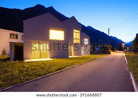 architecture, modern white houses, outdoor view by night - stock photo