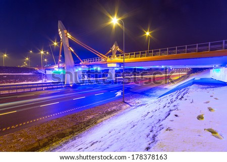 Architecture of bridge over bypass in Gdansk at night, Poland - stock photo