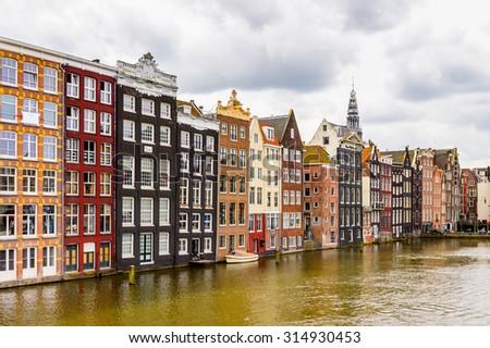 Architecture of Damrak street of Amsterdam, Netherlands. - stock photo