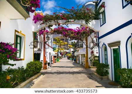 Architecture of Puerto de Mogan, a small fishing port on island Gran Canaria, Spain. Puerto de Mogan is called Little Venice of the canaries. - stock photo