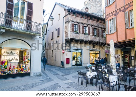 Architecture of the city of Como over the Lake Como, a lake of glacial origin in Lombardy, Italy. 20.04.2015  - stock photo