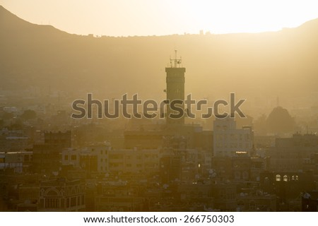 Architecture of the Old Town of Sana'a on the sun down, Yemen. UNESCO World heritage - stock photo