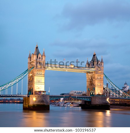 Architecture of Tower Bridge along River Thames London England United Kingdom at Dusk - stock photo