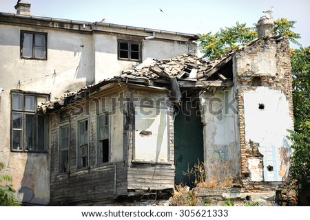 Architecture shot with the facade of a house in ruins - stock photo