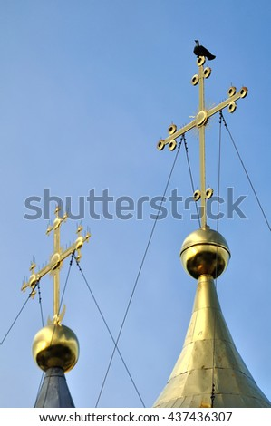 Architecture view - the crosses of Saint Sophia Orthodox Cathedral in Veliky Novgorod, Russia with a sitting metallic dove symbolizing the Holy Spirit. It is the oldest Orthodox church in Russia. - stock photo