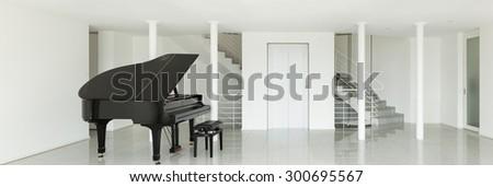 Architecture, wide hall with grand piano, interior - stock photo