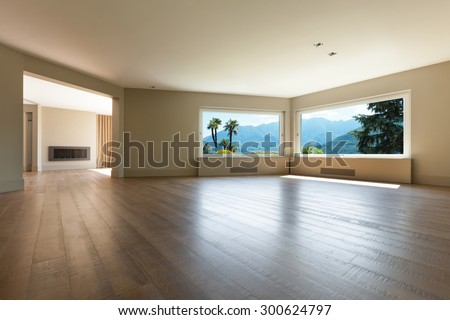Architecture, wide living room with windows, parquet floor - stock photo