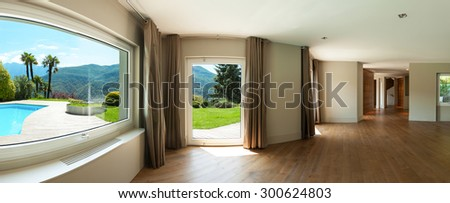 Architecture, wide panorama of a living room with windows, parquet floor - stock photo