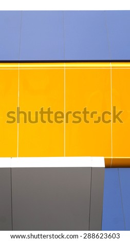 architecture yellow and blue metal cladding for exterior design - stock photo