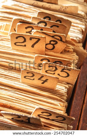 Archive file folders in drawer closeup toning - stock photo