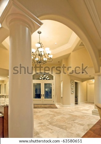 Archway and entryway in luxurious new home - stock photo