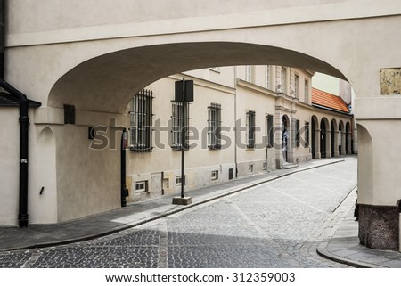 archway in a street of Warsaw in historical part of the city - stock photo