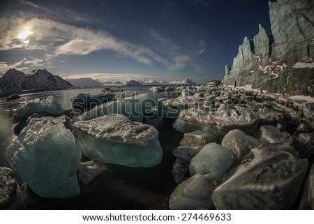 Arctic glacier landscape in the moonlight - Spitsbergen - stock photo