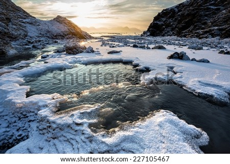 Arctic landscape - freezing river - Spitsbergen, Svalbard - stock photo
