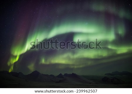 Arctic landscape with Northern Lights - Spitsbergen - stock photo