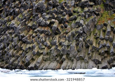 Arctic rocks background - basalt or touchstone formations - stock photo