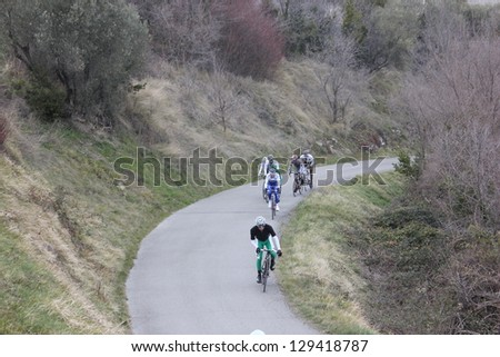"ARDECHE, FRANCE - FEB 24: Julien El Fares leading a group of 7 in UCI Europ TOUR ""LES BOUCLES DU SUD ARDECHE"" race. Matthieu Drujon won the race on February 24, 2013 in Sampzon Rock, Ardeche, France. - stock photo"