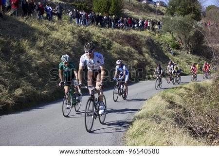 "ARDECHE, FRANCE - FEB 26: Professional cyclist Sylvain Georges racing the UCI Europ TOUR ""LES BOUCLES DU SUD ARDECHE"". Remi Pauriol wins the race on February 26, 2012 in Sampzon Rock, Ardeche, France. - stock photo"